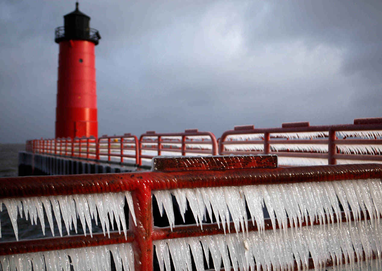 Icicles cling to the railings near the lighthouse on Lake Michigan during a cold snap.