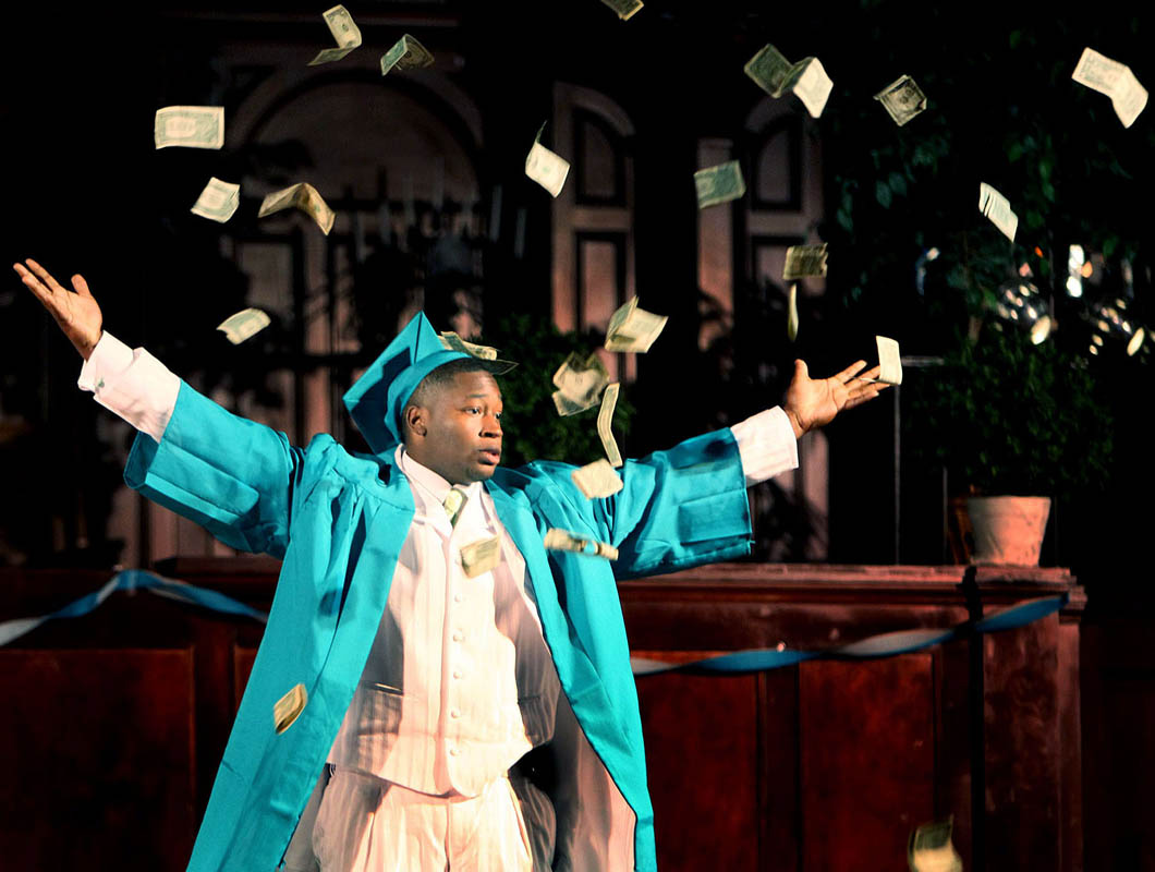Antonio Nickelson tosses $100 in $1 bills, celebrating as he is about to receive his diploma at his graduation from New School for Community Service. {quote}In the future I'll be making so much money I'll be throwing it in the air,{quote} said Nickelson. He plan is to attend UW-Whitewater and wants to study accounting.