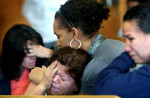 The family of Julio Cruz reacts after hearing the 19-year-old's sentence--10 years in prison--for the death of his 6-month-old son in March. Cruz pleaded guilty to second-degree reckless homicide and will serve 10 years in jail and an additional 5 years of probation.