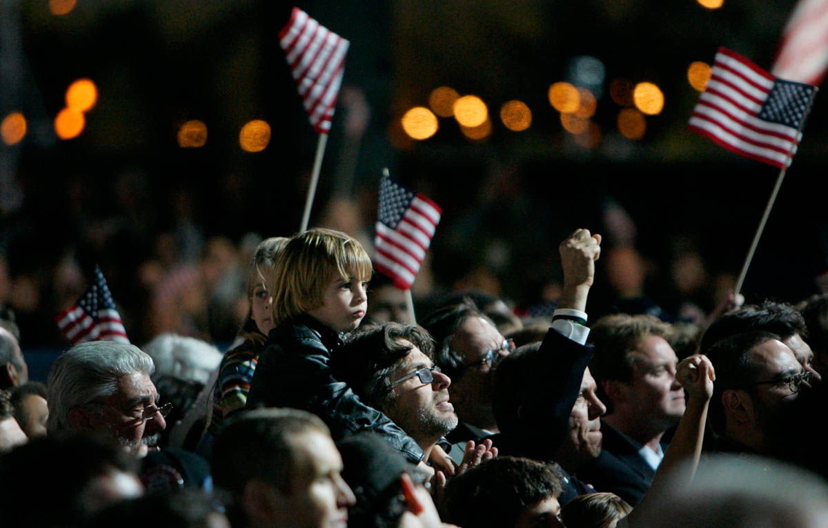 In the ticketed area, flags were waived as the crowd stared up at the projection screens, awaiting news that Senator Obama had won the election.