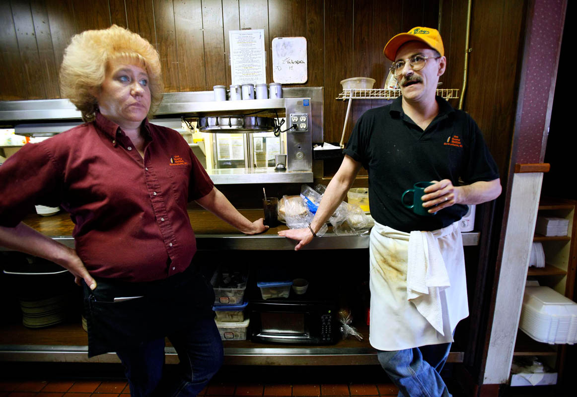 Kim Reinhard (left) and her husband Tom spend their last days working at The Rusty Skillet. The pair have worked there as waitress and chef for the past 12 years, and their three teenage children are employed there as well. The service industry has been his especially hard with the recession, and the restaurant will be closing it's doors, leaving the entire family of 5 out of work.