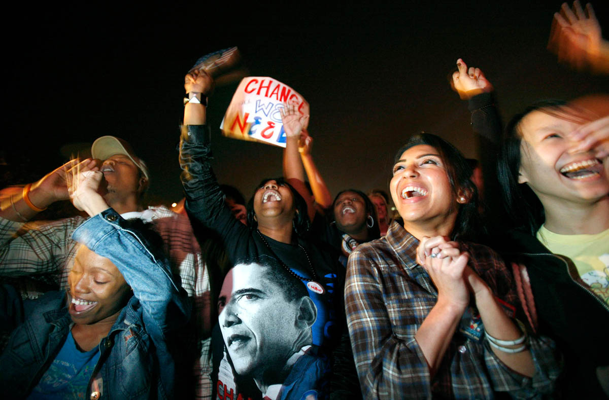 Obama's win seems imminent, and the crowd begins celebrating--Jessica Bealer of Chicago (left), Dominique Johnson of Chicago (center left),  Shivani Parikh of Chicago (center right), and Mikki Yuen of Chicago (right), believe that their candidate has clinched the election.