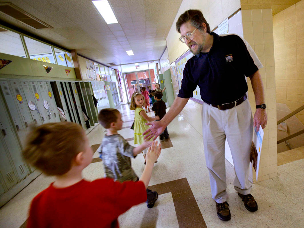 With the loss of the family income, many parents are not able to continue sending their children to private schools. A sharp decline in enrollment in the past few years is forcing schools like Holy Angels School in West Bend to make tough decisions. Holy Angels will be combining many of their classes with another private school that is also struggling. School principal Mike Sternig gives high fives to students in the hallway.