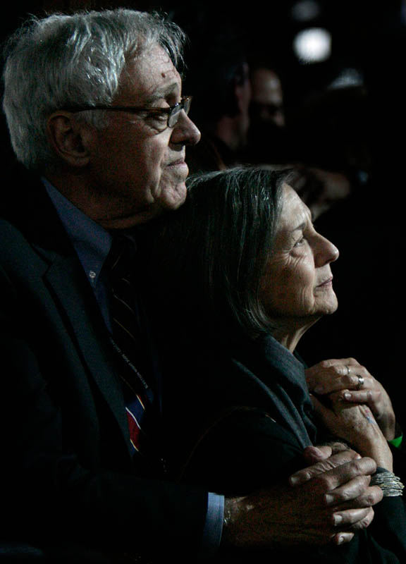 A couple holds one another as they listen to President-elect Obama's address.