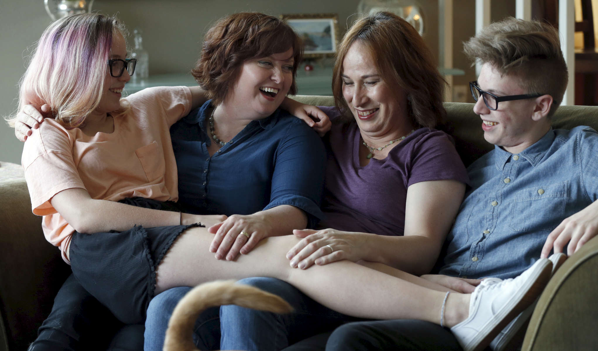 The Kachirisky family (left to right) Avery, 13, Kris, Aly and Owen, 16, pile together on a couch, April 21, 2016. Aly and Kris Kachirisky just celebrated their 19th year of marriage. The West Linn couple redefined their relationship following Aly's announcement that she was transgender and eventual transition.Kristyna Wentz-Graff/Staff
