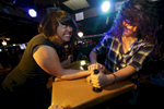 K. Paul (left) is pinned by Helen {quote}The Pole{quote} Paz in the championship match. A ladies-only arm wrestling tournament was held Friday night, April 22, 2016 at the Spare Room Restaurant & Lounge in Portland, raising funds for Portland's Rock 'n' Roll Camp For Girls. Over 35 competitors took the stage in the single-elimination tournament.Kristyna Wentz-Graff/Staff