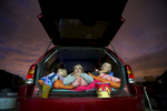 The Haight family from Grand Ronde (left to right) Hemi, 4, her mother Kiri, and Tommy, 8, watch the movie. Moviegoers enjoy a night at the theater at the 99W Drive-In Theatre in Newburg, June 18, 2016. The theatre opened in August 1953 and continues operating under the third-generation owner, Brian Francis. Kristyna Wentz-Graff/Staff