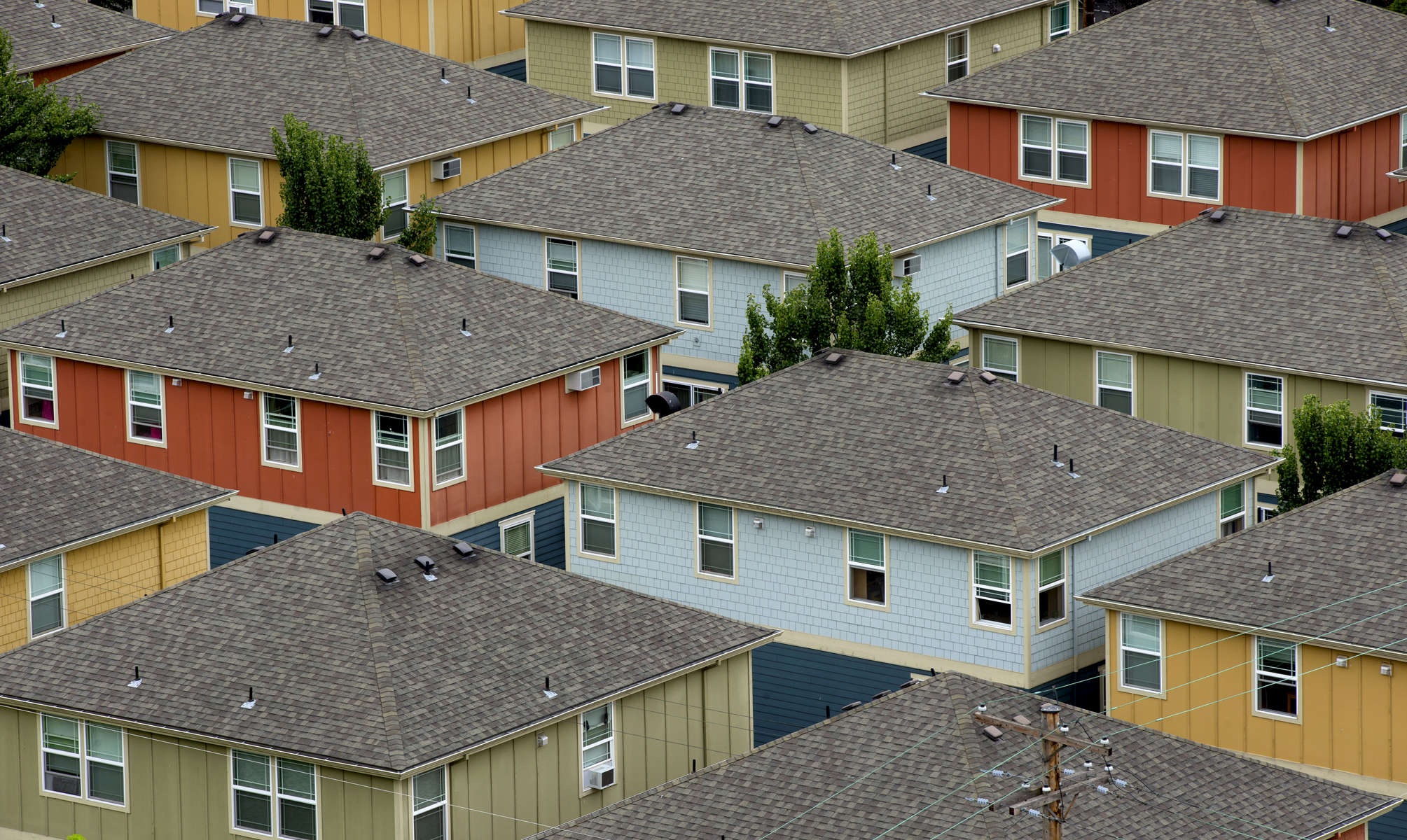Views from above can lend a fresh perspective to every day views. This cluster of houses becomes a study of color and symmetry when viewed from above. This photo was taken from atop the St. Johns Bridge in Portland, August 1, 2015. Kristyna Wentz-Graff / Staff