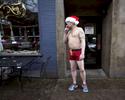 Sean Bettis of Portland has a quick smoke before taking part in the 6th annual Santa Speedo Run in 2014.