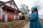 Dawn Powell stands in front of one of her 4 boarding-room houses. No tenants are currently living in that house after one resident died last year due to safety violations that Powell did not fix. Her residences have received numerous health and safety violations but often are not followed through by the city. She currently has 8 tenants that she provides breakfast and dinner to. {quote}As a home owner and a rental person, I would rather deal with people that kind of have mental problems,{quote} says Powell.