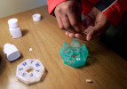 Maxine Lane sorts out her medication under the supervision of her case manager. Regulation of medication is left up to individuals although many are on a variety and large quantities of pills. Good case managers often help sort out the pills during visits, but there are many who are left to figure it out on their own.