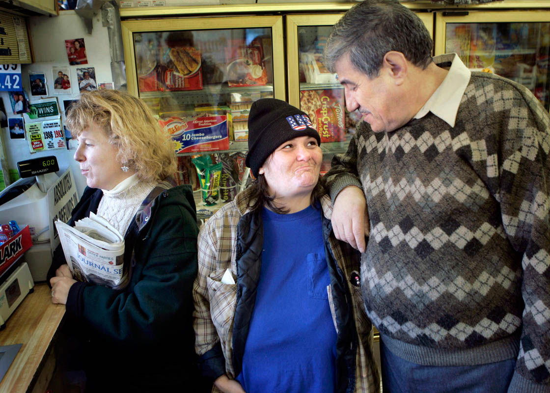 Some people, such as Diane Gronowski, center, who has schizophrenia, have built their own support network. Janet's caseworker Janet Van Peursem, left, is dedicated and caring, helping Diane with all facets of her life. Joe Asad, right, and his wife Nancy have created a small place for Diane to live in the back of their grocery store, have given her a job at their laundromat, and given her a lot of support.