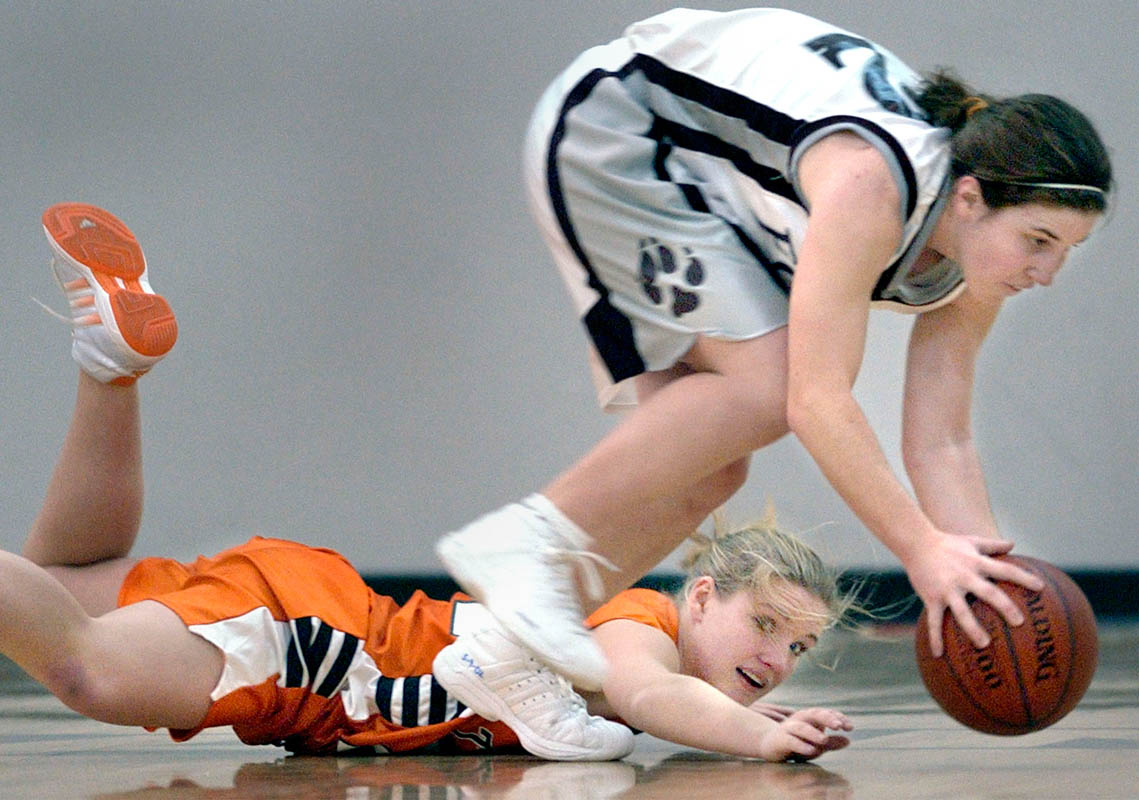 Rachel Schmidt, (right) of Fox Valley Lutheran gains control of the ball despite efforts by Clintonville's Jen Jirschele in the first half of Thursday night's game at Fox Valley Lutheran.