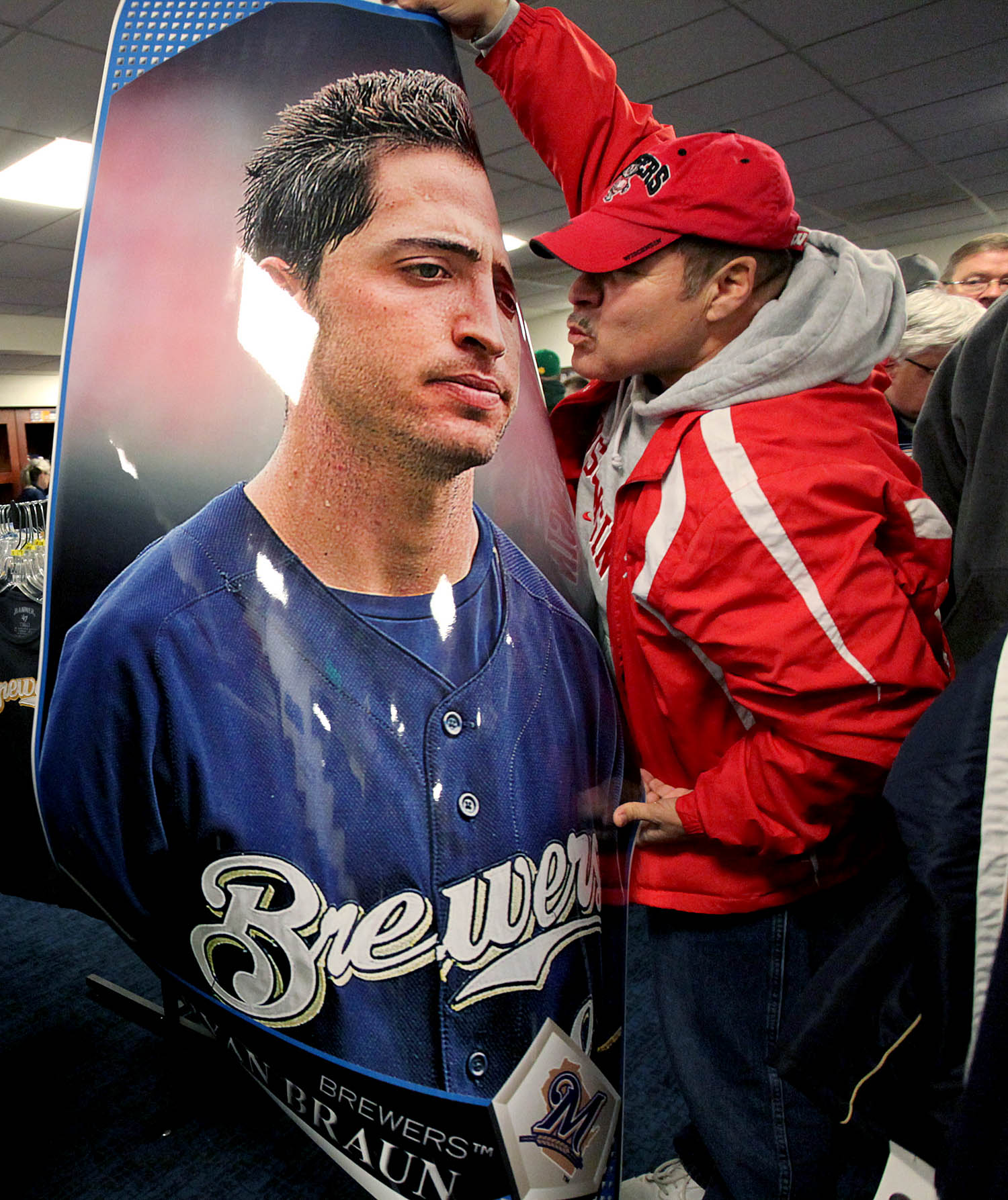 {quote}This is all I want for Christmas,{quote} says Victor Moreno of Racine as he puckers up to an oversized Ryan Braun poster he scored at the Milwaukee Brewers Annual Clubhouse Sale at Miller Park. His wife quickly responded {quote}that's all you are getting.{quote}