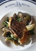 deptolla nws kwg 4--Sauteed Atlantic striped sea bass is served with clams, fingerling potatoes, leeks, arugula and parsley, at Harbor House in Milwaukee, October 25, 2010.PHOTO:KRISTYNA WENTZ-GRAFF / KWENTZ@JOURNALSENTINEL.COM