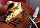 deptolla fea kwg 4--Banana amaretto cheesecake at Stubby's Pub & Grub in Milwaukee, November 12, 2010. The cheesecake is served with bruleed bananas, amaretto whipped cream and chocolate drizzle. Everything on Stubby's menu is made in-house, including dressings and smoking their own meats.PHOTO: KRISTYNA WENTZ-GRAFF / KWENTZ@JOURNALSENTINEL.COM