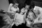 Courtney, center, is surrounded by neices Brooke Johnson, 16, far right, Baylee Johnson, 3, left, Brittney Henrie, 12, top left, Courtney's sister Juli Henrie, top right, as they relax in Courtney's room, April 8, 2007 in Genoa City. Courtney will live with her oldest sister Juli and her family, with all the nearby family members helping with her care.