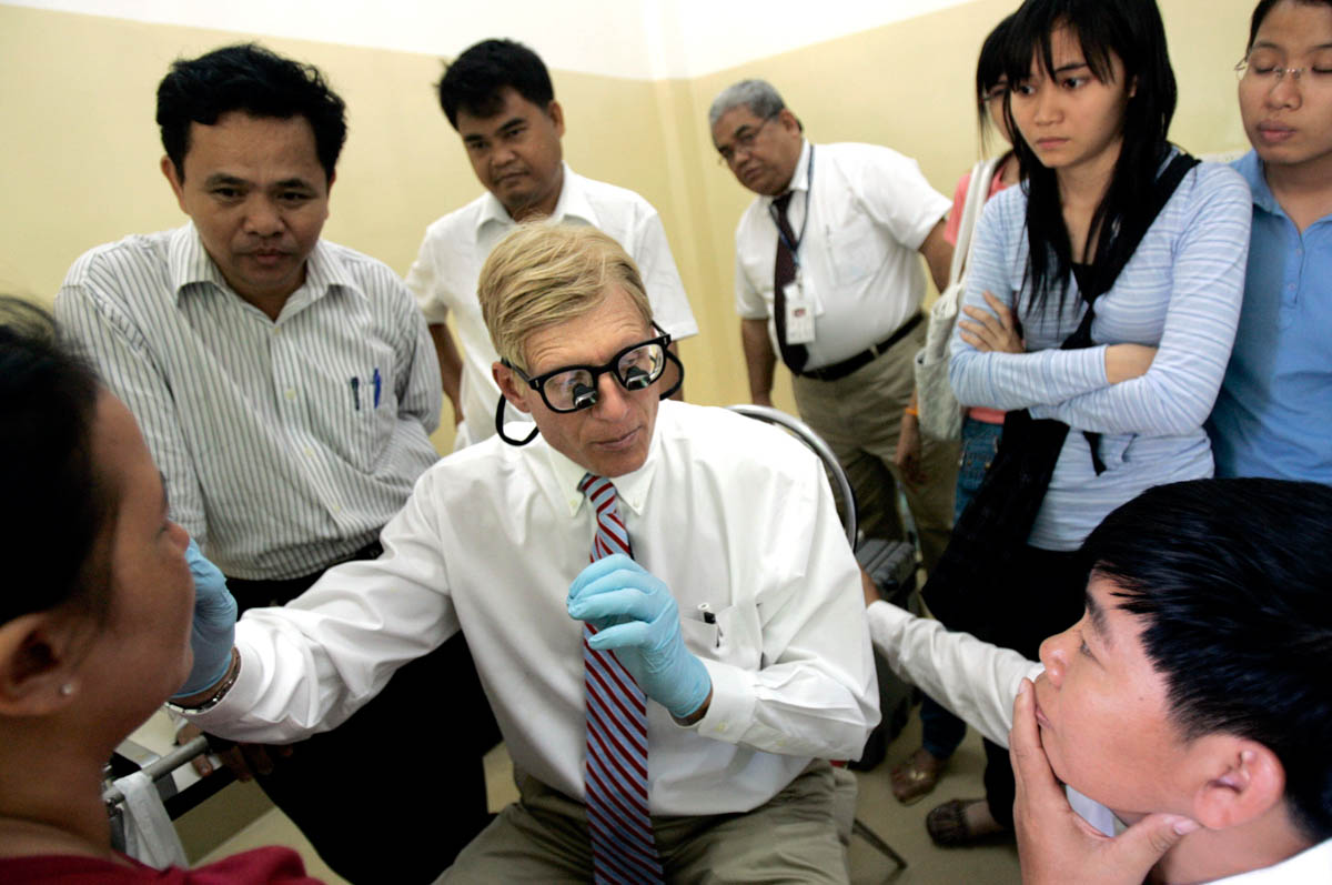 The primary objective of the ORBIS program is training eye care personnel in all ranges, doctors, nurses and anesthestists. The entire program is based on the knowledge of volunteers such as Dr. Bob Kersten, associate professor at the University of Cincinnati, in Cincinnati, OH, who is examining a patient as a possible surgery candidate.