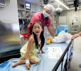 As volunteer anesthesiologist Dr. Artem Grush wheels Line Chea, 5, into the operation room for her surgery, she turns back and cries for her mother, aboard the ORBIS Flying Eye Hospital. Line was the first surgery performed for the 100th trip of the plane, and the first of the program in Cambodia.