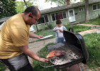 Izzy's father, Diego, flips burgers as the family grills at Izzy's home. Children become aware of their gender between 1 and 2 years of age.