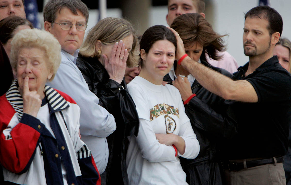 {quote}This is not the homecoming you ever imagined,{quote} says Kristen later, about watching Ricky's casket be unloaded at the Kenosha Regional Airport. The family stood huddled together on that damp, cold morning. Kristen's father Todd Fedler, right) strokes her head as she watches Ricky's casket be unloaded at the Kenosha Regional Airport tarmac. Also with Kristen are Ricky's family, grandmother Edith Mercier, far left, father Lennie, center left, and mother Susan.