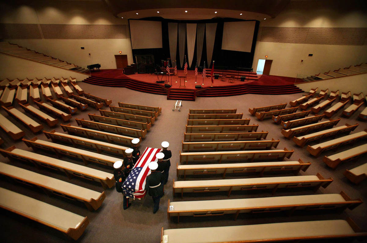 Marine's carry Ricky's casket into the empty church in preparation for his funeral at First Assembly of God in Kenosha.