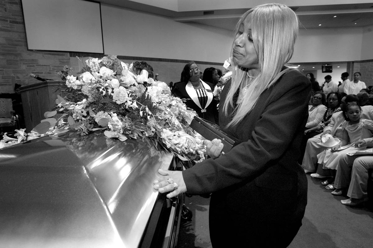 Angela Virginia can't bring herself to say goodbye to her son and oldest child, Purvis, at the conclusion of his funeral service.
