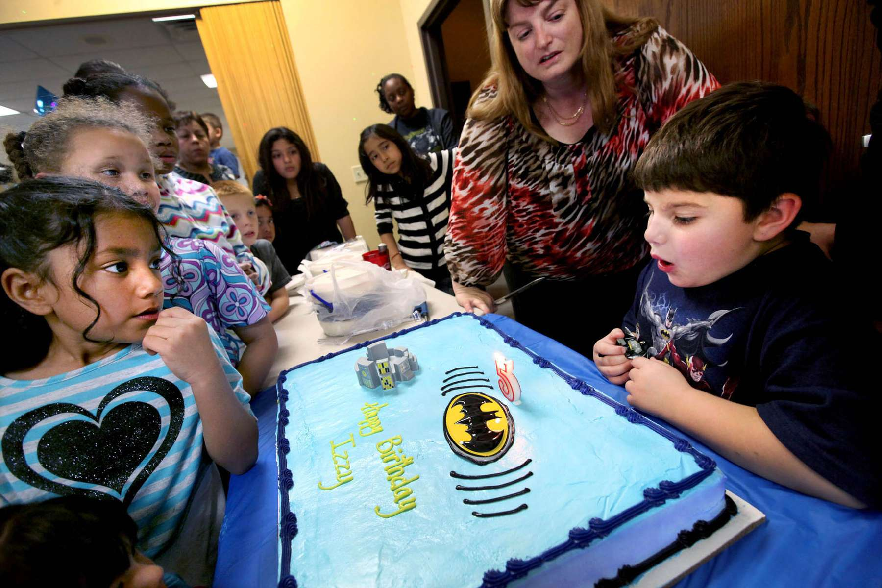 Izzy blows out his birthday candle during his Batman themed birthday party. He has just turned five and will soon be stepping out of the relative safe bubble in terms of dealing with gender.