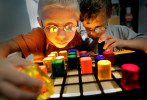 Peter Sotski, 4, (left) and friend Michael Diaz, 4, work with a light box in their classroom at the Center for Blind & Visually Impaired Children in Milwaukee, Wis. Both boys have very low vision and attend the center to learn the life skills necessary to navigate in a world they can't see.