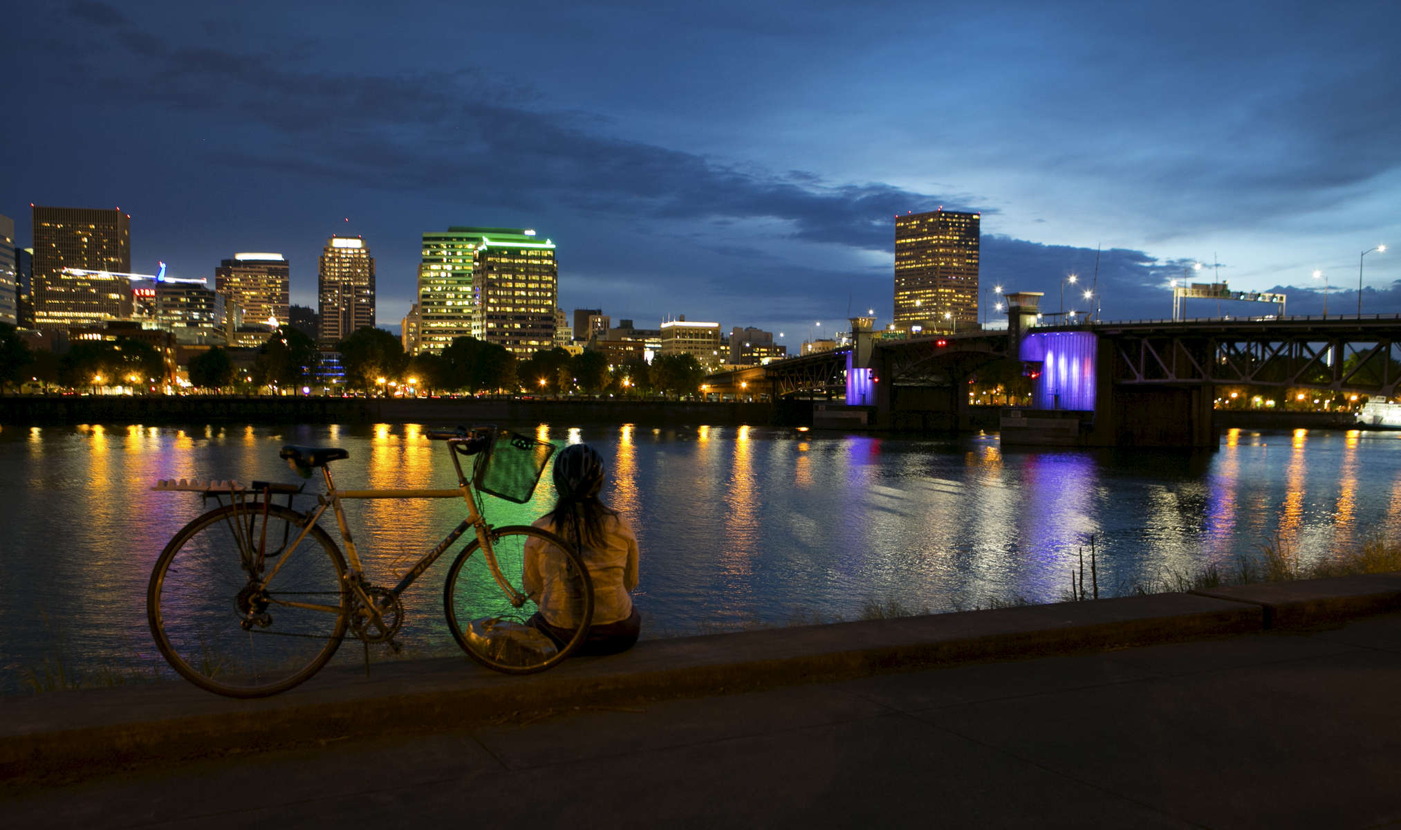 Portland's Morrison Bridge was bathed in purple light on Thursday night, April 21, 2016, in honor of legendary music artist Prince who died Thursday morning. Kristyna Wentz-Graff/Staff