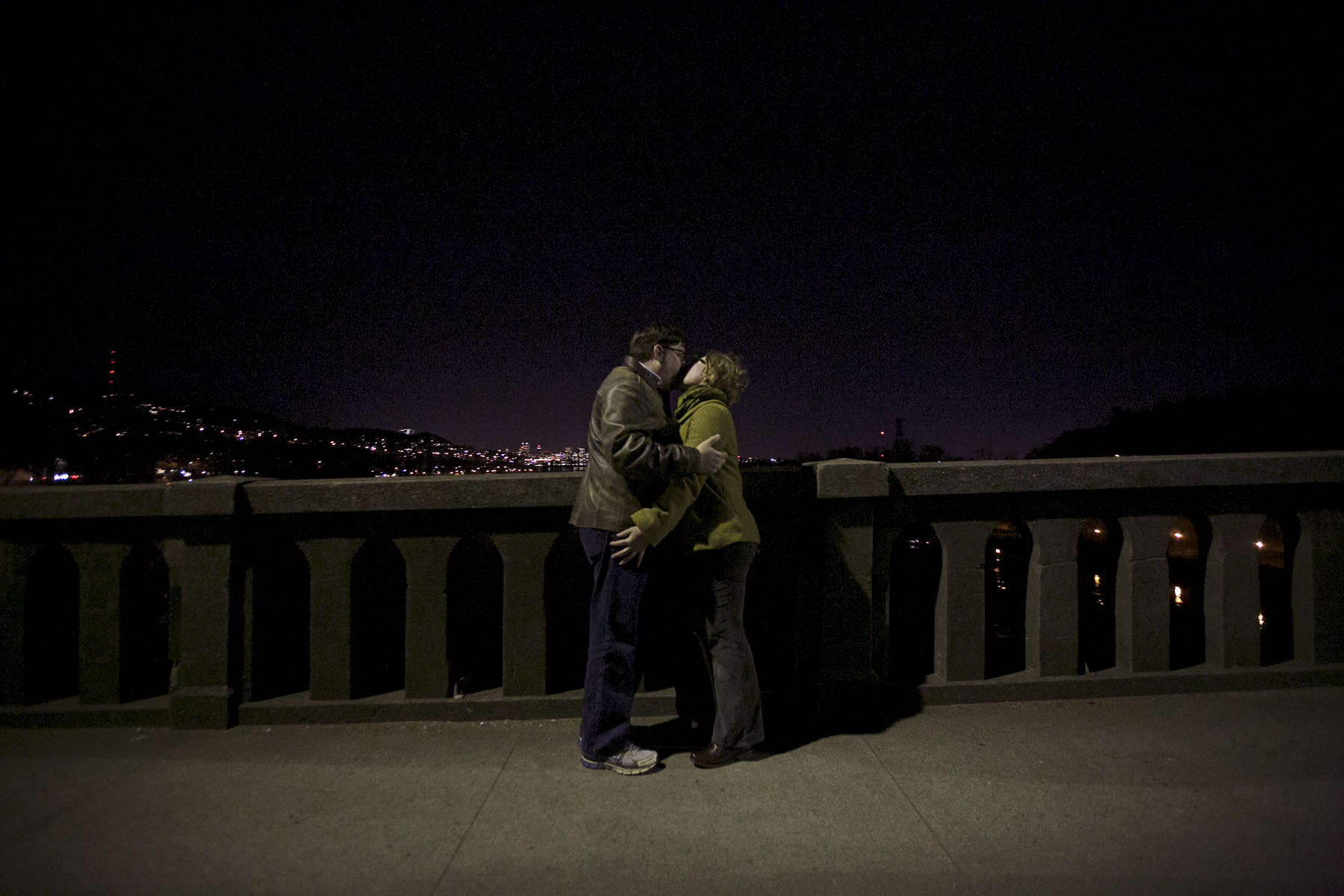 A couple has a romantic kiss atop the old Sellwood Bridge in Portland during the final hours of public access on the 90-year-old bridge before it is replaced.