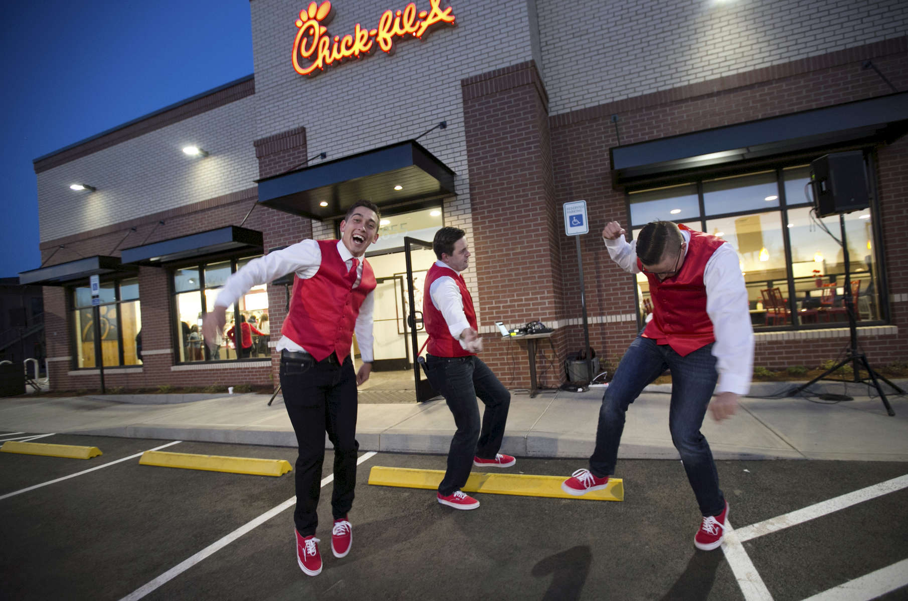 Roman Kotowski, Matt Peele and Chris Rich celebrate the opening of Oregon's first Chick-fil-A in Hillsboro.