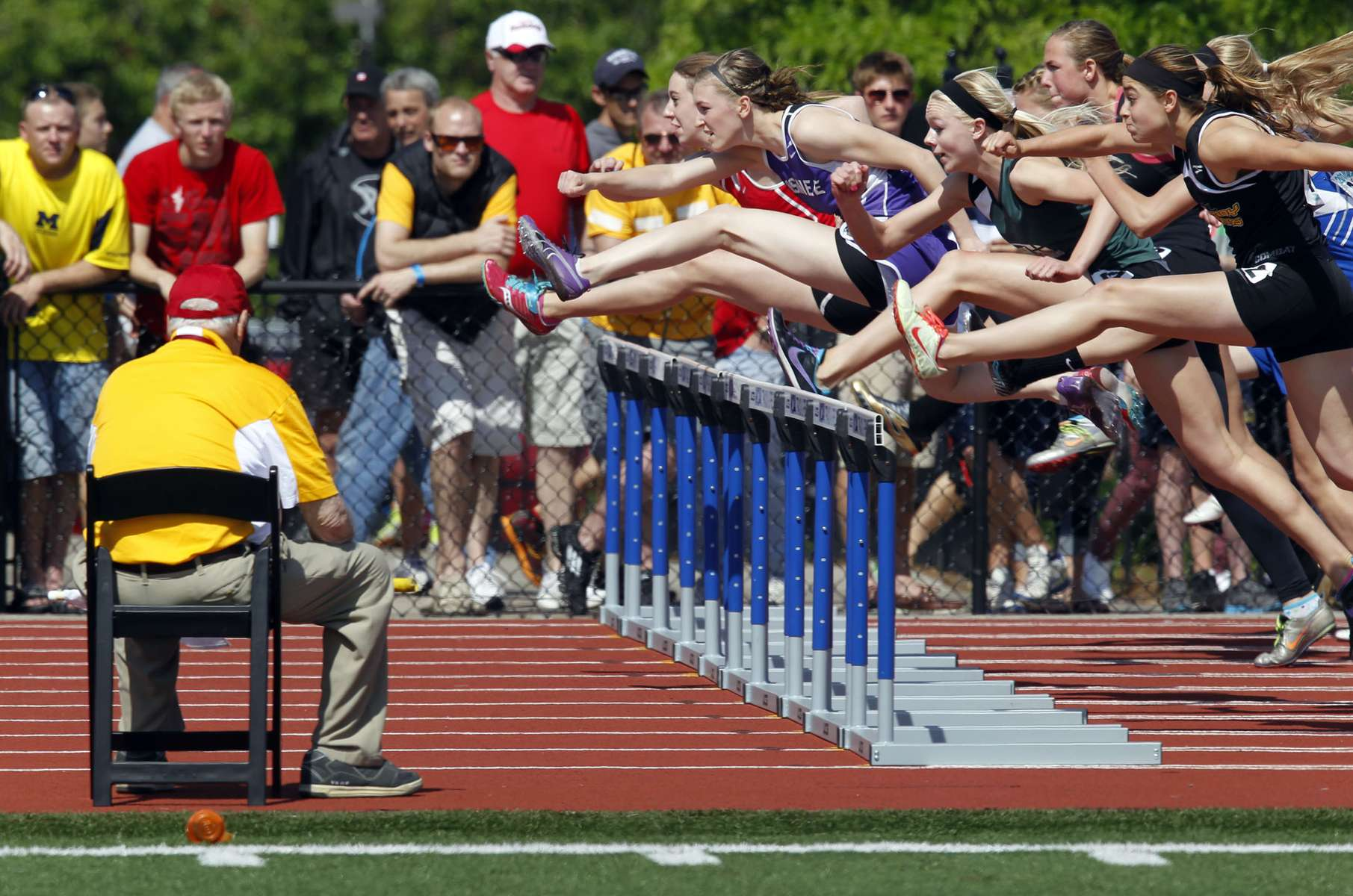 Division 2 girls compete in the second heat of the 100-meter high hurdles at the WIAA 2013 Boys & Girls State Track and Field Division.