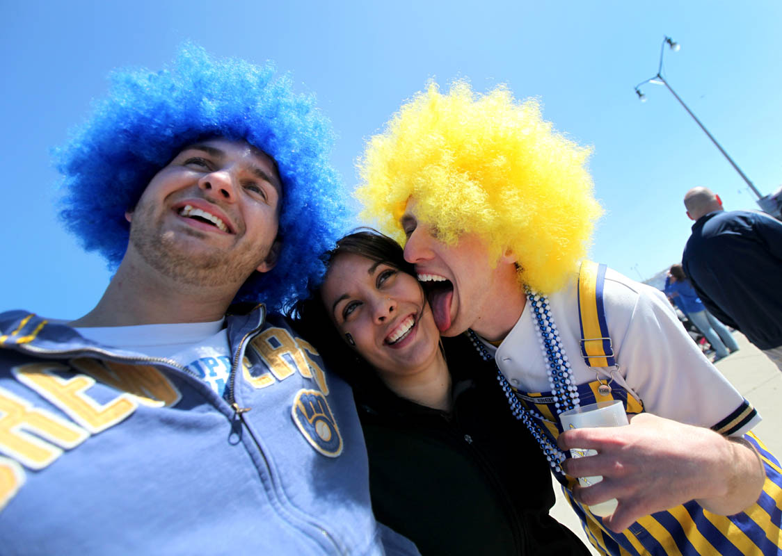 Troy Saddy (left) poses for a photo with his sister, Rachell Saddy as their friend Josh Swan of Muskego gives her an impromptu lick. The trio were at Miller Park on Opening Day of the 2012 Milwaukee Brewers season.