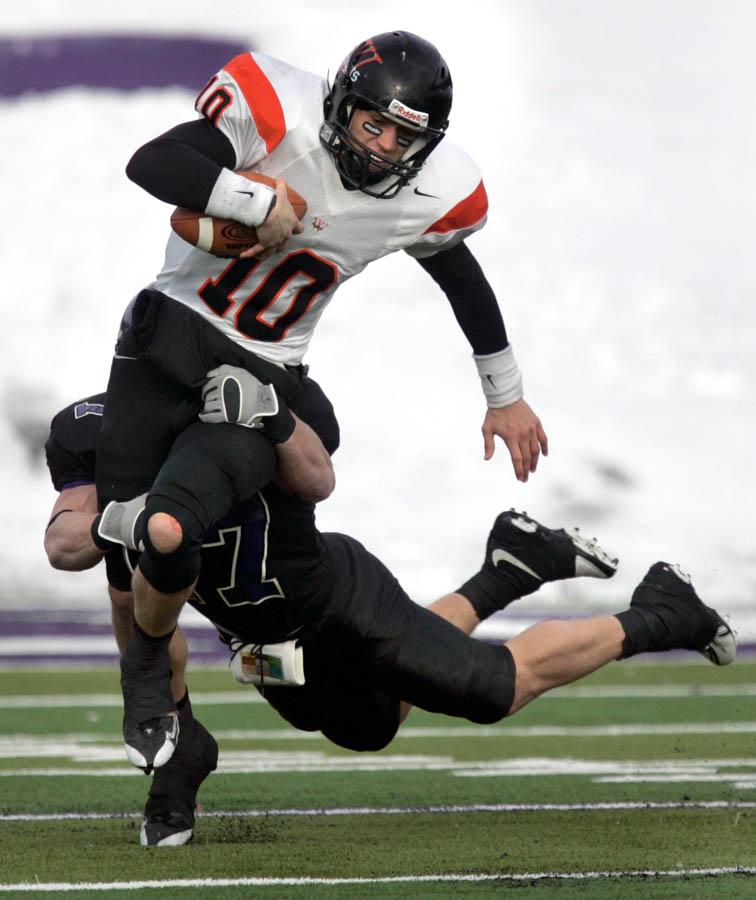 UW-Whitewater's Lane Olson,(back) brings down Wartburg College's quarterback Nick Yordi during  Saturday's Division III national semifinal game held at Perkins Stadium in Whitewater.