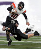 UW-Whitewater's Lane Olson,(back) brings down Wartburg College's quarterback Nick Yordi during  Saturday's Division III national semifinal game held at Perkins Stadium in Whitewater.