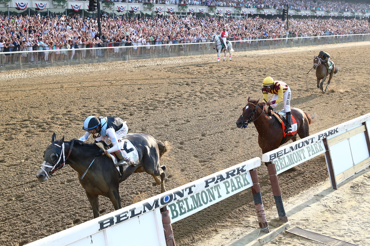 Jose Otriz is up on Tapwrit leading to victory as Irish War Cry with Rajiv Maragh up is second in The 149th running of the Belmont Stakes at Belmont Park on June 10, 2017 in Elmont, New York.