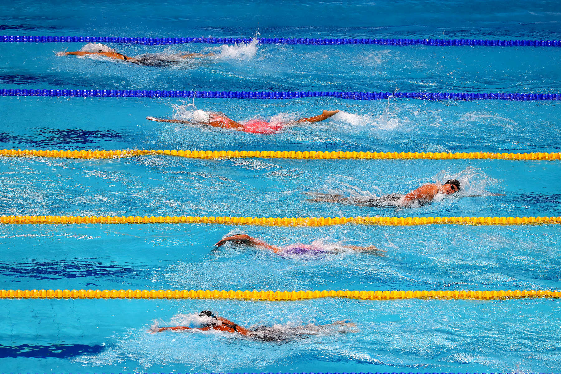Katie Ledecky (C) of the United States laps her fellow competitors during the Women's 1500m Freestyle final on day twelve of the Budapest 2017 FINA World Championships on July 25, 2017 in Budapest, Hungary.