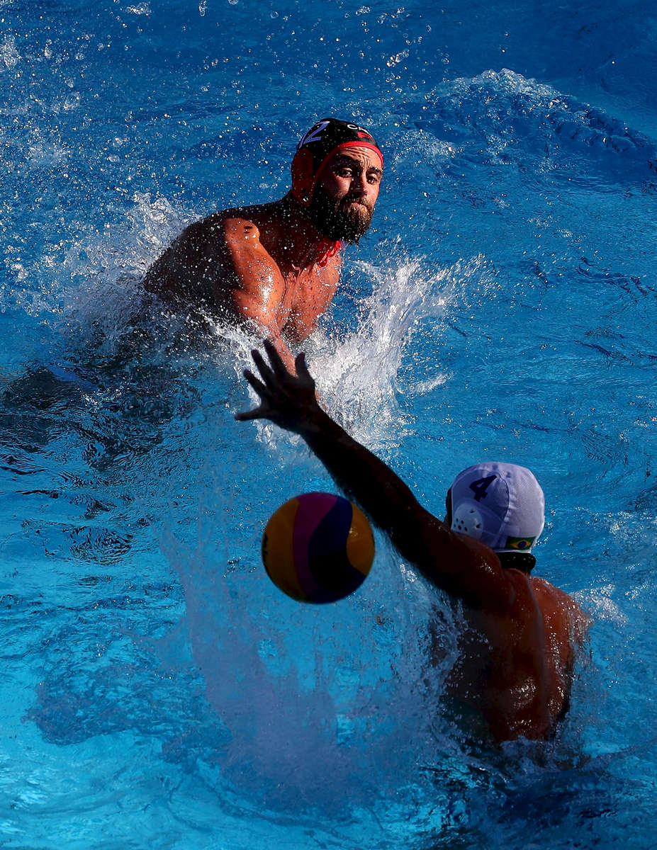 Devon Ross Thumwood (black) of Canada shoots past Gustavo Coutinho (white) of Brazil  during the Men's Water Polo Group A, preliminary round match between Brazil and Canada on day eight of the Budapest 2017 FINA World Championships on July 21, 2017 in Budapest, Hungary.