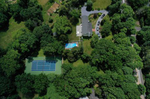 An aerial view of ATP Tennis player Noah Rubin of the United States training at a friend's home on June 18, 2020 in Laurel Hollow, New York.  He hopes to qualify for the 2020 US Open which is scheduled to take place without fans beginning  on August 24th.  Athletes across the globe are now training in isolation under strict policies in place due to the Covid-19 pandemic.