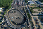An aerial view of a cars racing around the track during NASCAR Advance Auto Series Opening Night at Riverhead Raceway on August 01, 2020 in Riverhead, New York.  The race track had been closed due to the coronavirus COVID-19 pandemic.  More than 4,585,258 people in the United States alone have been infected with the coronavirus and at least 154,000 have died.