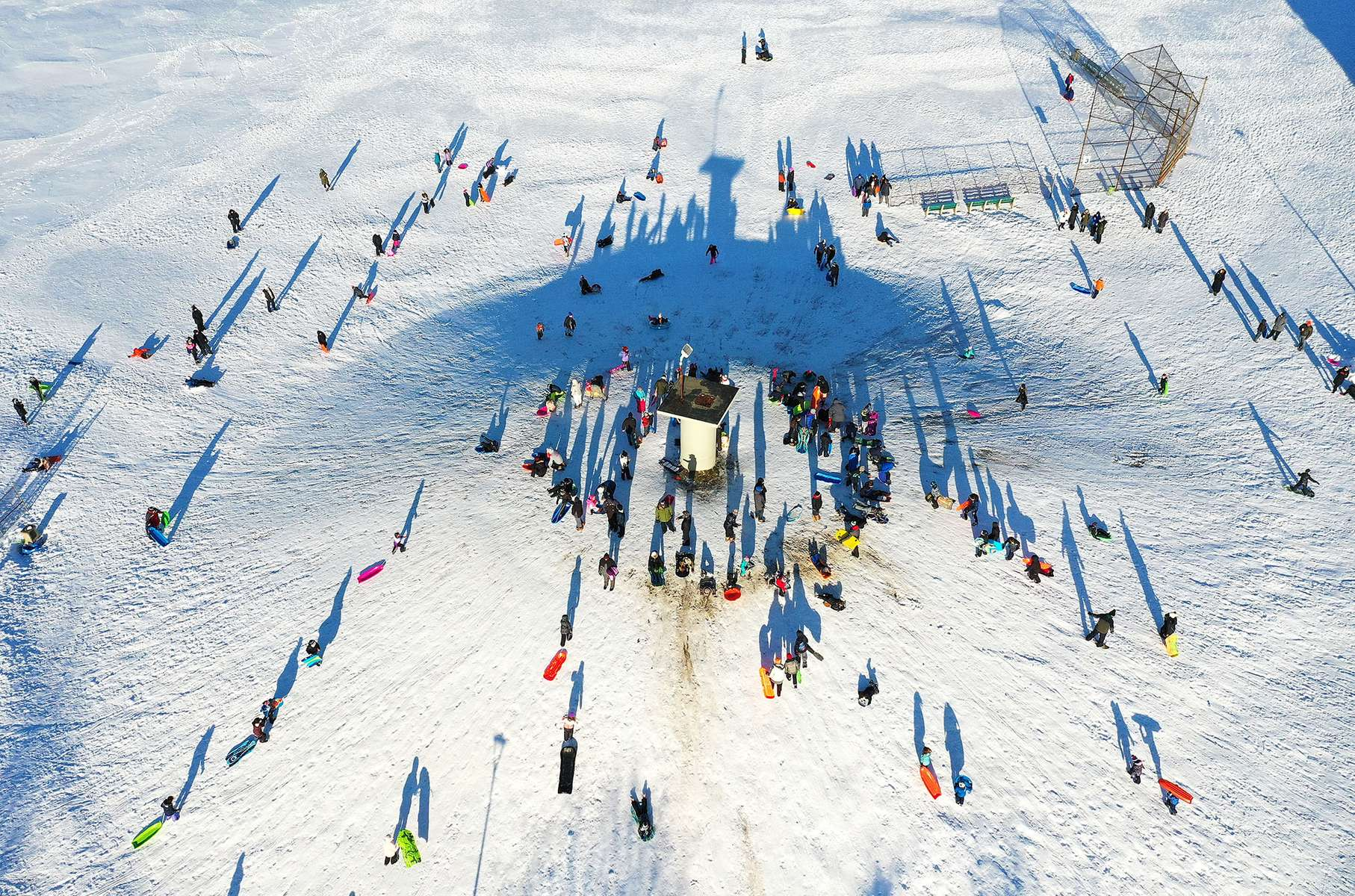 An aerial view of people sledding at Newbridge Road Park on December 17, 2020 in Merrick, New York. Many parts of the Northeast were hit with heavy snowfall in the first big storm of the season.