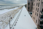 An aerial view of a man running along the boardwalk on December 17, 2020 in Long Beach, New York. Many parts of the Northeast were hit with heavy snowfall in the first big storm of the season.