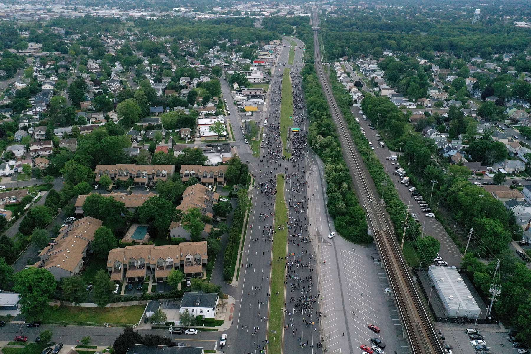 An aerial view of protesters marching to demonstrate the death of George Floyd on June 04, 2020 in Merrick, New York.  Minneapolis Police officer Derek Chauvin was filmed kneeling on George Floyd's neck. Floyd was later pronounced dead at a local hospital. Across the country, protests against Floyd's death have set off days and nights of rage as its the most recent in a series of deaths of black Americans by the police.
