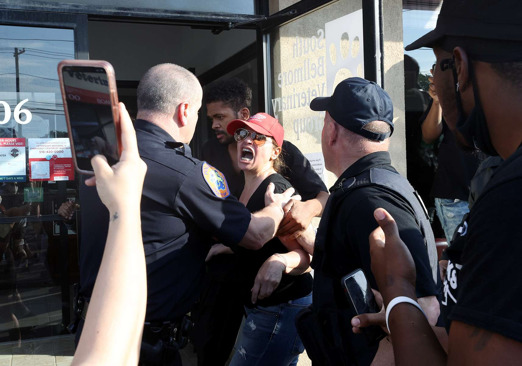 A woman is detained by Nassau County Police after disrupting the Protest for George Floyd on June 04, 2020 in Merrick, New York.  Minneapolis Police officer Derek Chauvin was filmed kneeling on George Floyd's neck. Floyd was later pronounced dead at a local hospital. Across the country, protests against Floyd's death have set off days and nights of rage as its the most recent in a series of deaths of black Americans by the police.