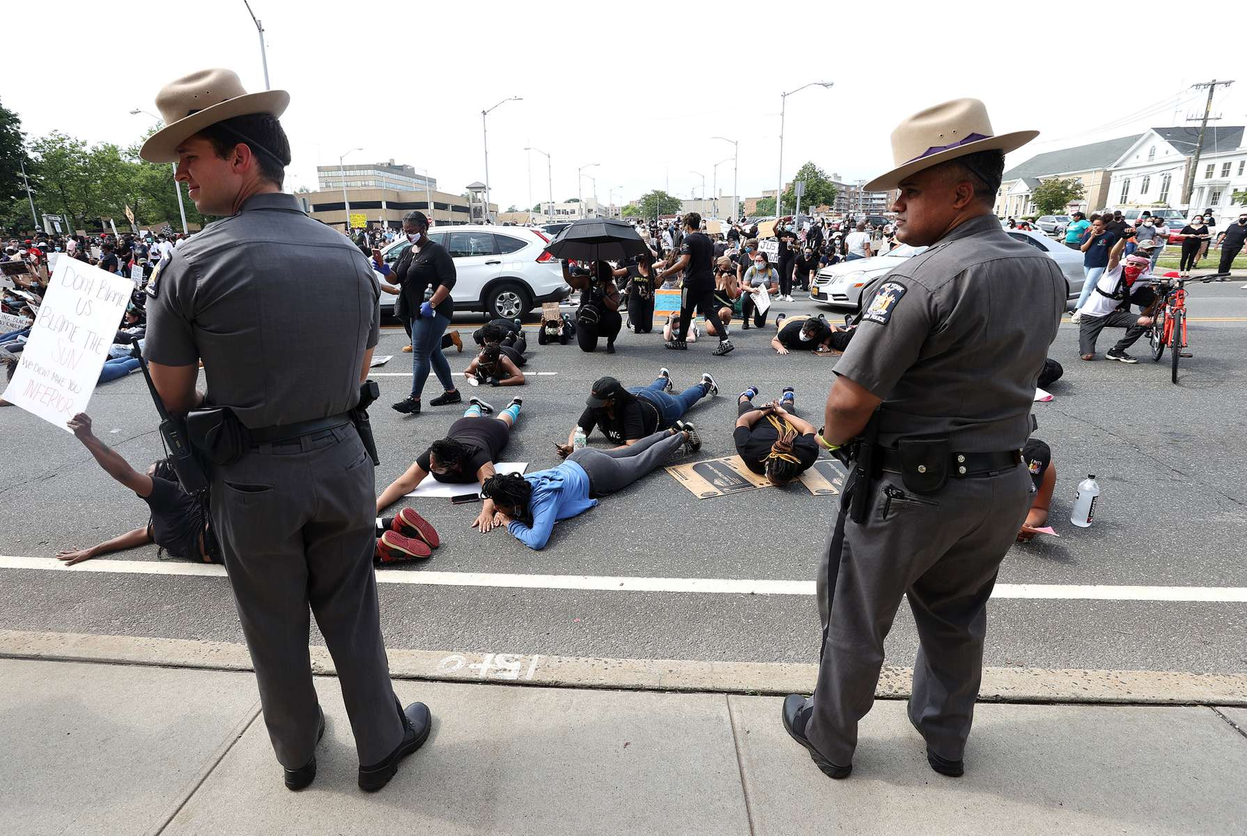 People protest over the killing of George Floyd by a Minneapolis Police officer on June 05, 2020 in Hempstead, New York. The white police officer, Derek Chauvin, has been charged with second-degree murder and the three other officers who participated in the arrest have been charged with aiding and abetting second-degree murder. Floyd's death, the most recent in a series of deaths of black Americans at the hands of police, has set off days and nights of protests across the country.