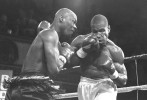 Former USA Olympian Antonio Tarver (left) hits Jason Burrell with a left hook during their bout at Fight Night at the Blue Horizon on April 29, 1997 in Philadelphia, Pennsylvania