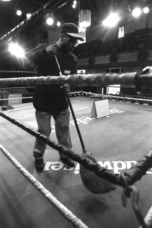 Former fighter Jake Bellows cleans the ring before Fight Night at the Blue Horizon on April 29, 1997 in Philadelphia, Pennsylvania