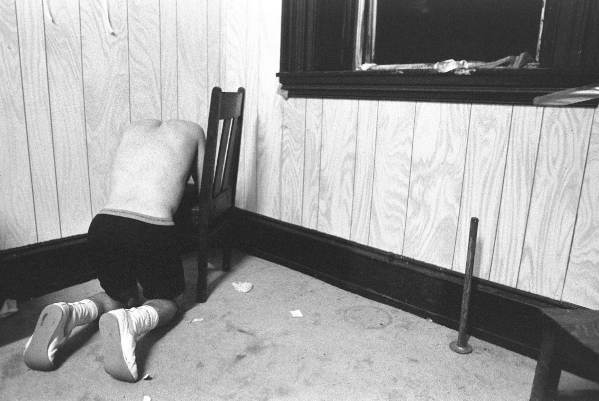 Santos Lopez kneels in the corner upset after loosing his bout to John Brown during Fight Night at the Blue Horizon on May 21, 1996 in Philadelphia, Pennsylvania