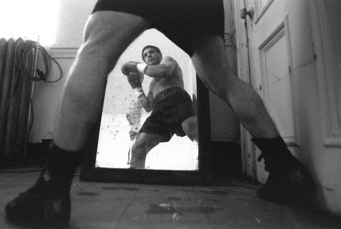 James Salava warms up in front of a mirror prior to a bout during Fight Night at the Blue Horizon on April 29, 1997 in Philadelphia, Pennsylvania